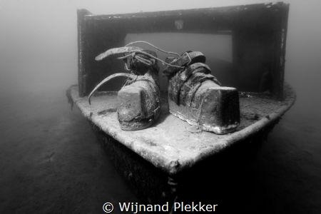 Old school diver shoes on little wreck in Kempervennen La... by Wijnand Plekker