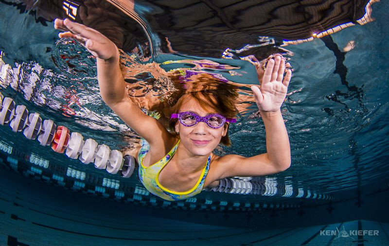 Just Hanging Out swim team girl taking a break by Ken Kiefer