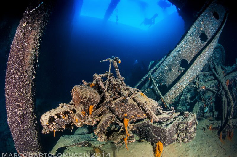 Motorcycle in the Valfiorita wreck wwII Italian Ship by Marco Bartolomucci