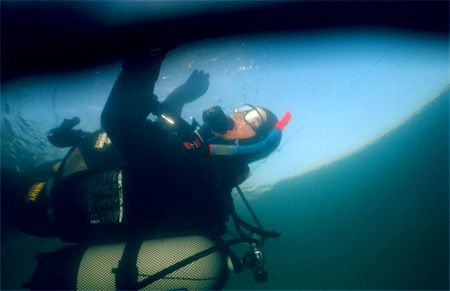 Diving under ice in a mine-lake. by Gyula Zombor