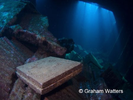 Inside the hold of the Chrisoula K Wreck in the Red Sea by Graham Watters