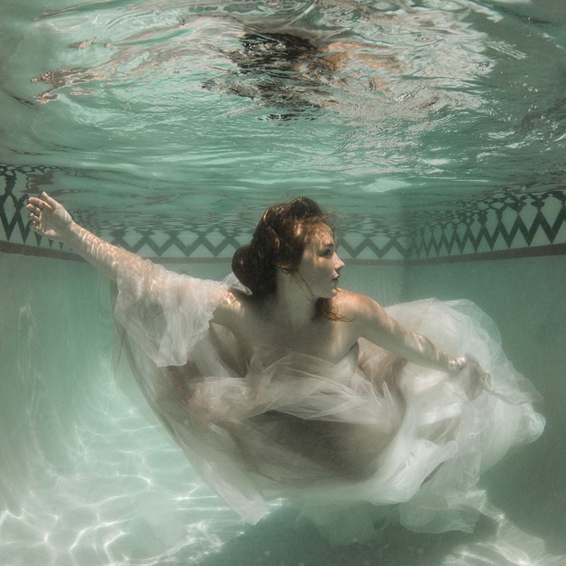 Post wedding shoot in a small, private pool. by Helen Brierley