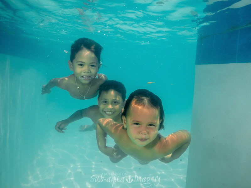 Three kids swimming by Jan Morton
