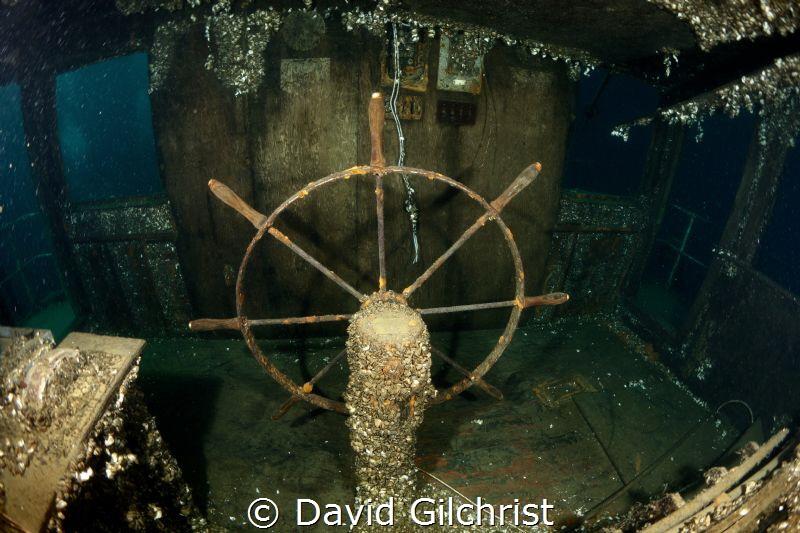 ShipsWheel on the Niagara II, Near Tobermory, Ontario. by David Gilchrist