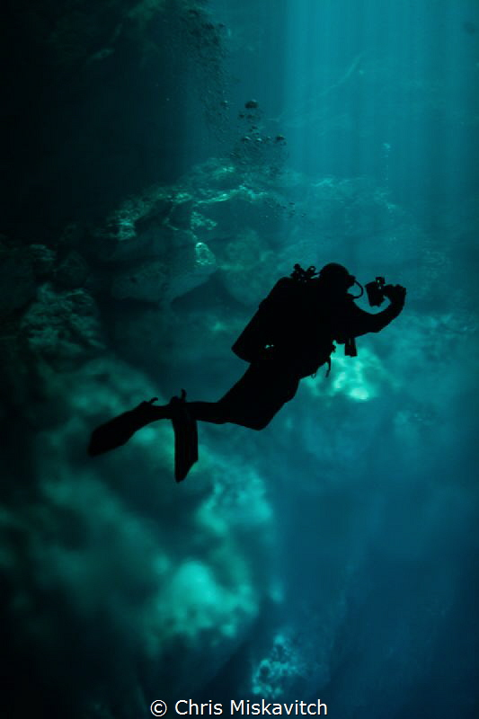 Light in front of this diver as he comes out of the shado... by Chris Miskavitch