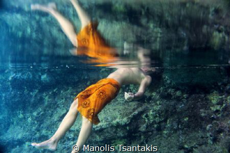 Underwater reflection by Manolis Tsantakis