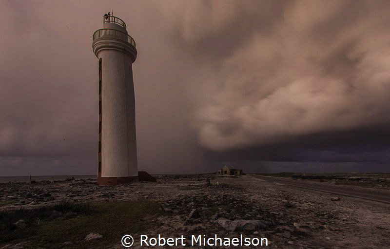 Passing Storm at dawn at dive site Lighthouse Point, Bonaire by Robert Michaelson