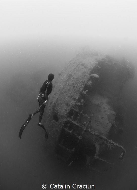 Freediver at Morazan Maru , Japanese WWII ship wreck in C... by Catalin Craciun