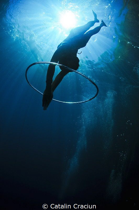 Freediving through the bubble rings . Taken in Coron usin... by Catalin Craciun