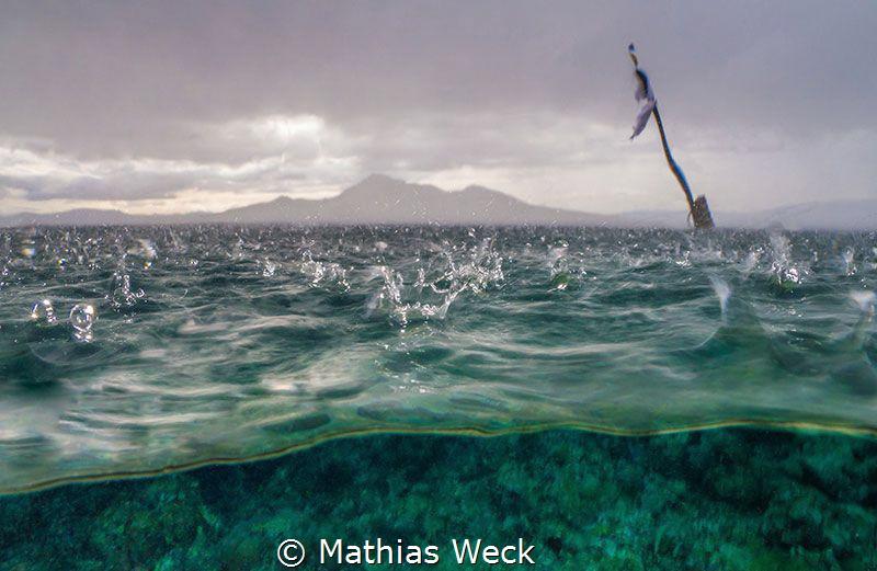 Tropical rain at Bunaken Island by Mathias Weck