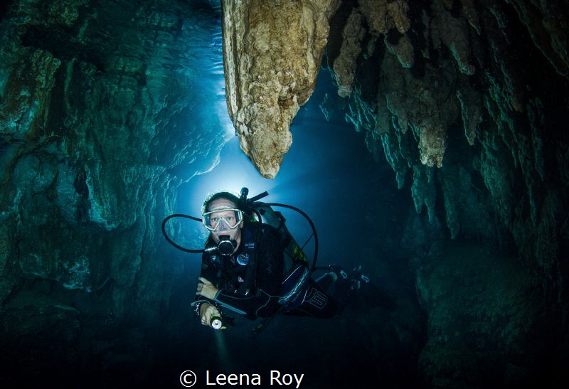 Diver in Chandelier cave by Leena Roy