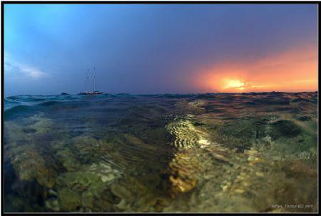On a sunset. by Sergey Lisitsyn
