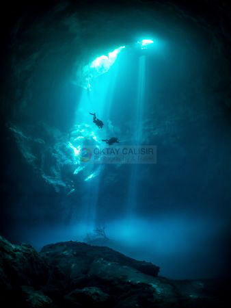 Divers decompressing after a cave dive in the Cenote 'The... by Oktay Calisir