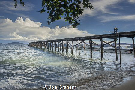 Jetty bathed in the early Morning Sun! Raja Ampat Dive Re... by Joe Graham