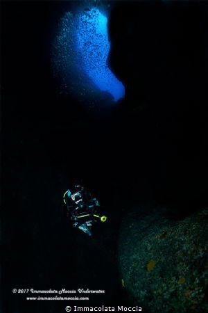 Inside the cave with scuba diver by Immacolata Moccia
