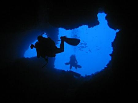 Cave divers in Raja Ampat by Dawn Watson