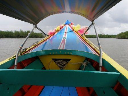 Exploring Phang Nga bay in a colourful long-tail boat by Gordana Zdjelar