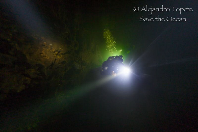 Lights under de cloud, Cenote Angelita México by Alejandro Topete