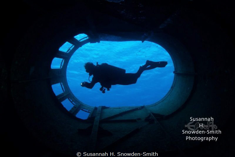 """Smokestack Silhouette"" - A diver is framed within the sm... by Susannah H. Snowden-Smith"