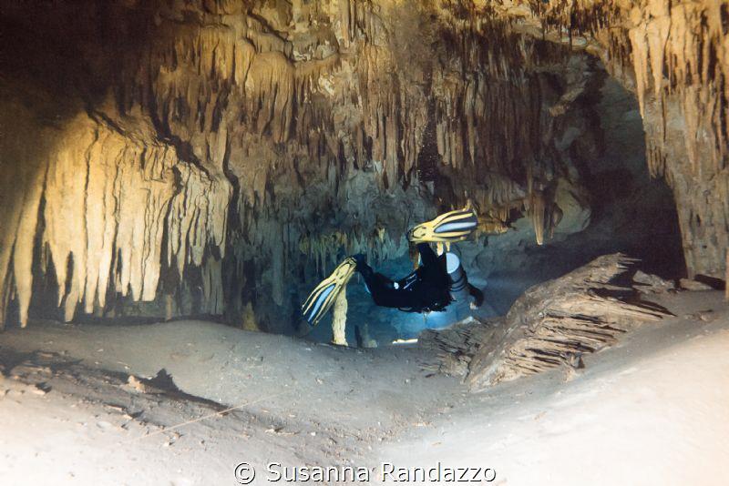 exploring cave stalagmites by Susanna Randazzo