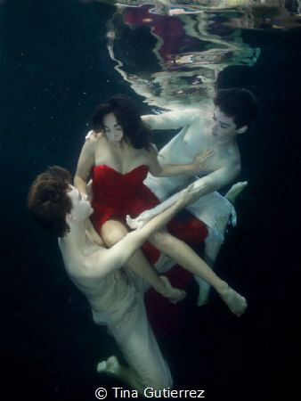 Ship wrecked in Red.  pool with Ballet Dancers by Tina Gutierrez