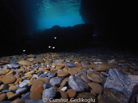 Pebbles Colourful bottom from the cavern by Cumhur Gedikoglu