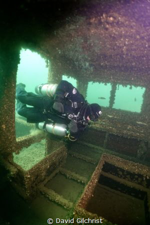 Sidemount Diver practicing skills to  enter wreck at the ... by David Gilchrist