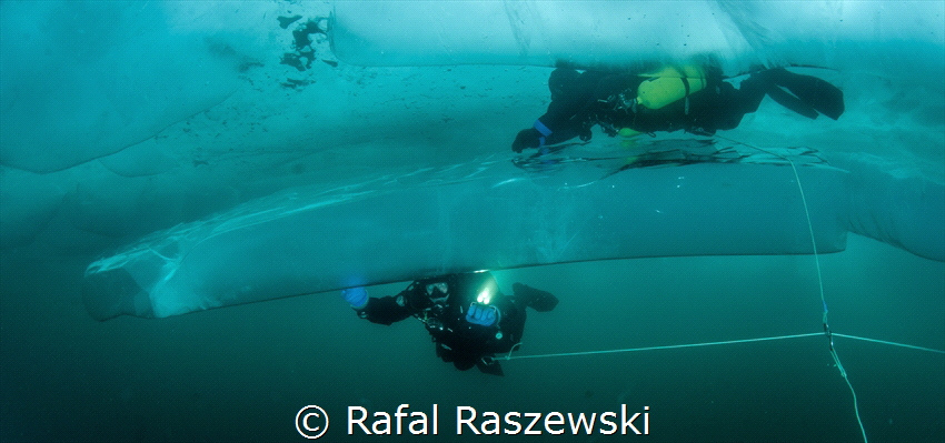 Baikal lake, ice diving, march 2019.Water temperature 0-1... by Rafal Raszewski