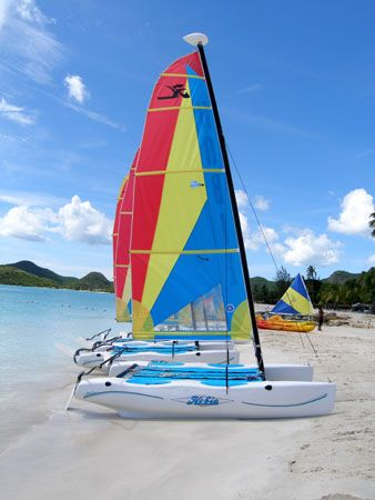 Hobbies chilling on the beach in Antigua by Anna Kinnersly