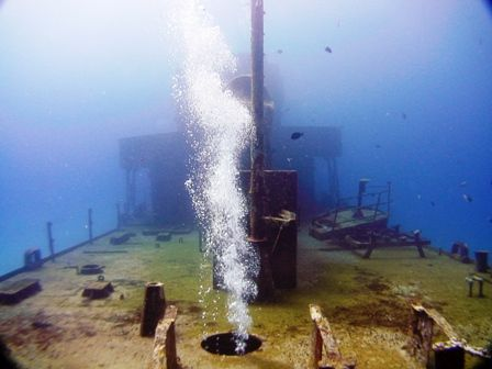 """Bubbles from diver penetrating the wreck """"Cañonero C53"""" a... by Kenn Bolbjerg"""