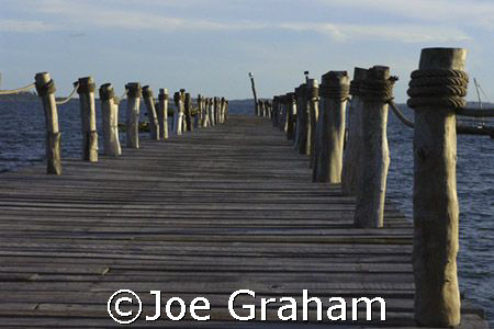 At the end of the jetty .......  by Joe Graham