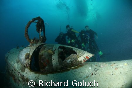 Group of divers posing with Betty Bomber-Truk Laggon by Richard Goluch