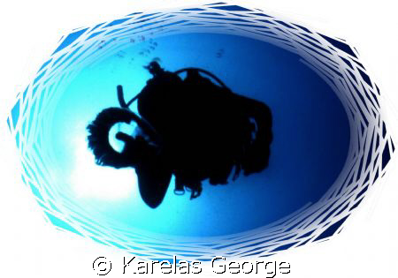 Transparent encounters-diver and jellyfish by Karelas George