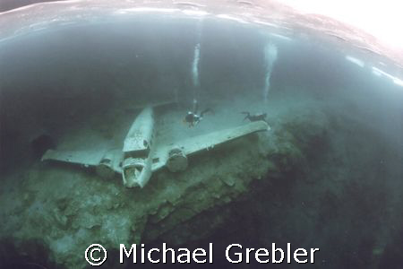 Airplane wreck under the ice at Morrison's Quarry, Quebec... by Michael Grebler