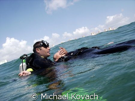 Rescue student contemplating rescue breaths off the beach... by Michael Kovach