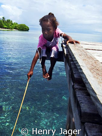 """Papua Girl's Fishing"" at Arborek's jetty, Raja Ampat, We... by Henry Jager"