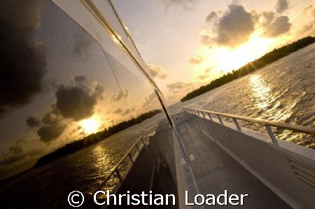 the Four Seasons Explorer liveaboard in the Maldives  N... by Christian Loader