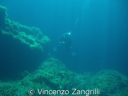 Divers raising from the blue.  Ustica Island, Sicily, I... by Vincenzo Zangrilli