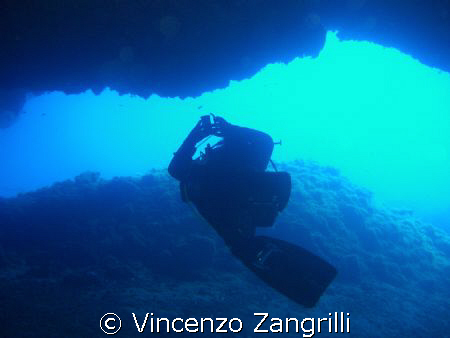 Diver getting into a canion in Ustica, Sicily, Italy by Vincenzo Zangrilli