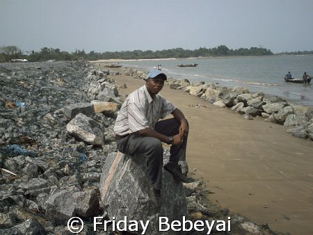 I am at the sea bank of the costal rock looking my countr... by Friday Bebeyai