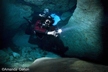 Cave Diving  Cave Diver making his way through the cave... by Amanda Cotton