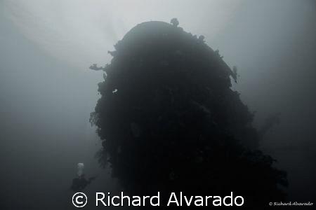 Bow of the Shinkoku Maru with dive buddy.  Ship sunk by A... by Richard Alvarado