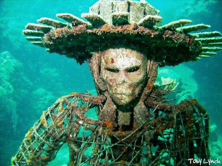 One of the many sculptures in the Underwater Sculpture Ga... by Toby Lynch
