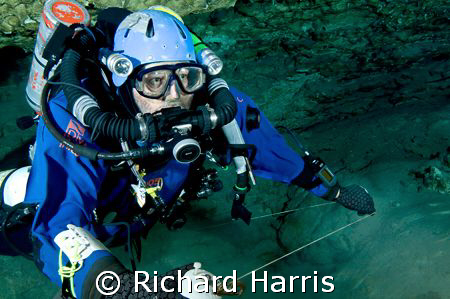 Making the jump. Cave diver running a jump reel. by Richard Harris