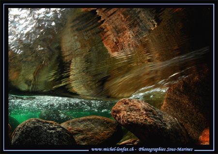 Fresh Water Reflection.... in the water's of the Verzasca... by Michel Lonfat