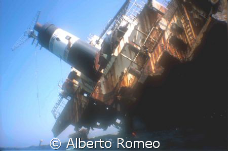 THE WRECK AND THE DIVER SNORKELING by Alberto Romeo