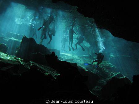 """""""Blue Fins""""   A group of tourist divers prepares to explo... by Jean-Louis Courteau"""