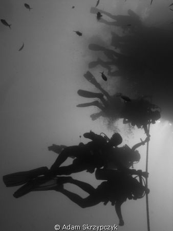Human flagpoles - divers waiting for safetystop at the HM... by Adam Skrzypczyk