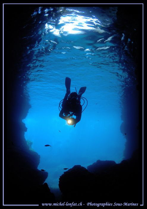 My wife Caroline entering a beautiful Cave in Malta : Que... by Michel Lonfat