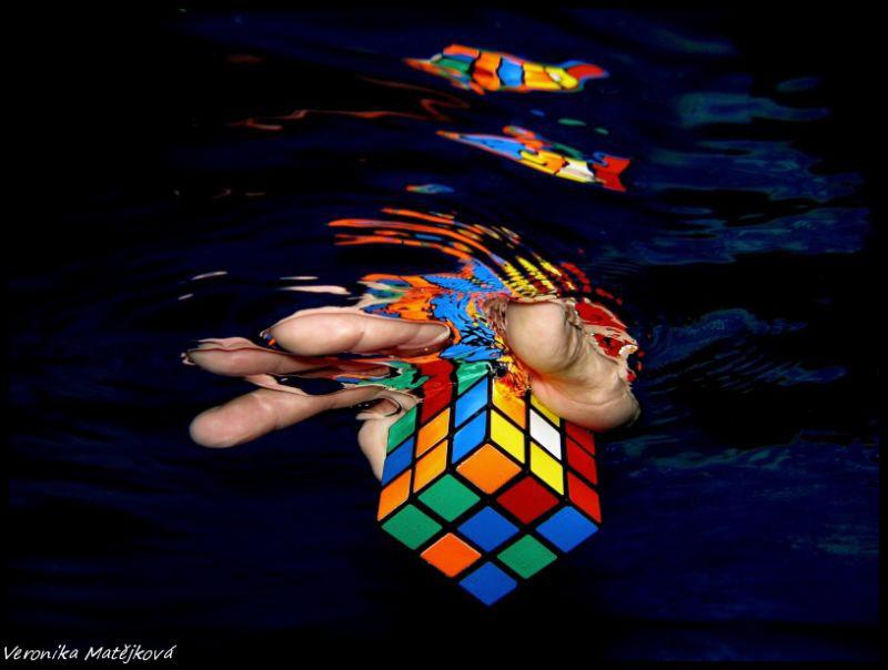 Taken in swimmingpool. Color cube in a hand by Veronika Matějková